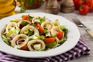 Salad with squid rings.