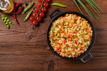Fried rice with chicken. Prepared and served in a wok.