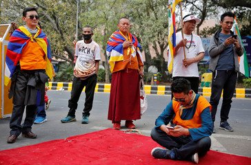 Tibetan exiles attend a protest held to mark the 10th anniversary of a Tibetan uprising against Chinese rule, in New Delhi