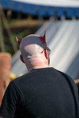 Bald Man with Unique Hairstyle with Red Horns: Rear View Portrait