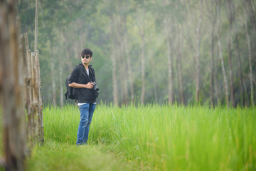 Photographer with camera at Rice fields on terraced Thailand landscape,Travel Lifestyle hobby concept adventure active vacations outdoor