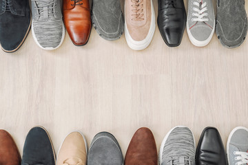 Different male shoes on wooden floor Wall mural