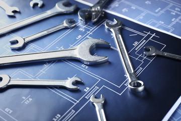 Plumber's tools on blueprint