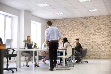 Office employees having meeting in conference room. Finance trading