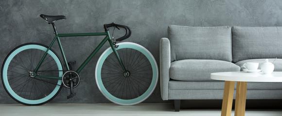 Bike and sofa in room interior