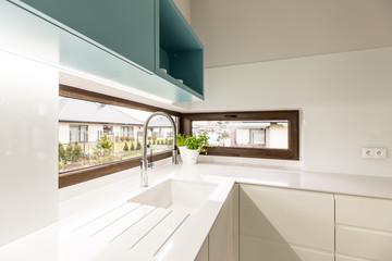 Windows in white kitchen interior