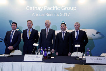 Cathay Pacific Group's Martin Murray, Rupert Hogg, John Slosar, Paul Loo and Greg Hughes attend a news conference in Hong Kong