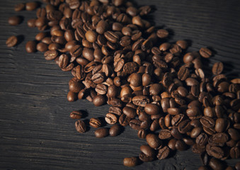 coffee beans on a black old  wooden bg