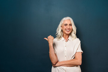 Mature old beautiful woman showing copyspace