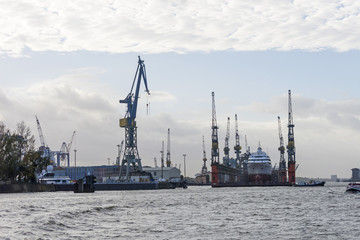 Transhipment cranes in Hamburg Port. Hamburg, Germany