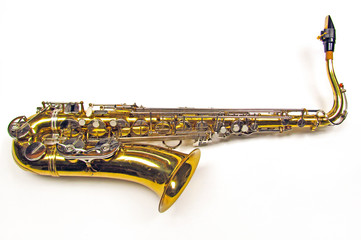 Old golden saxophone on white background.