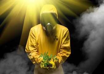 Man in chemical protection suit and green plant