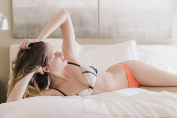 Attractive woman lying on bed