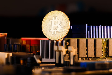 Image of crypto currency, bitcoin and processor on orange background