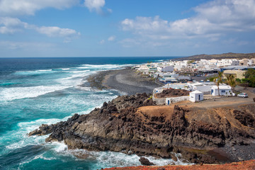 Beach and village of El Golfo in Lanzarote, Canary Islands, Spain