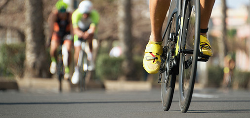 Door stickers Cycling Cycling competition,cyclist athletes riding a race,racing bike during ironman competition.Racing- bike