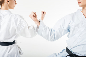 cropped image of karate fighters showing block with hands isolated on white