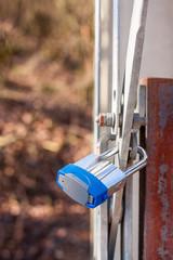 Padlock locks a special metallic electrical isolator