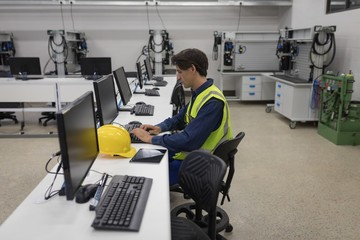 Male worker working on computer