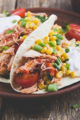 Chicken taco with corn, tomato and sour cream