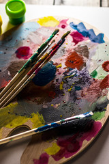 brush against the background of the palette
