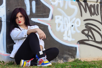 young woman with hip hop style at the skatepark