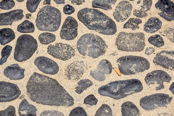 The abstract pattern of wall constructed with pebbles
