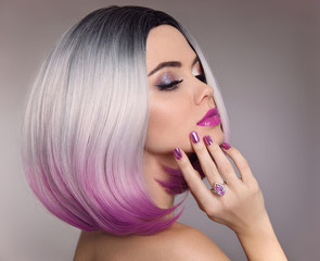 Ombre bob hair woman. Glitter Makeup. Manicure nails. Beauty Portrait of blond model with short shiny hairstyle. Concept Coloring Hair. Fashion jewelry