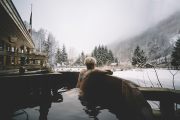 Woman swimming in plunge tub in winter