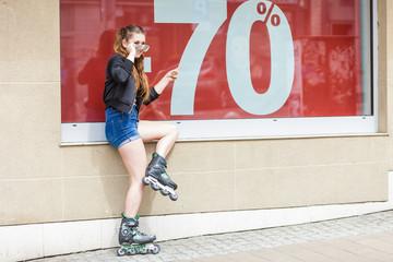 Woman wearing roller skates next to sale