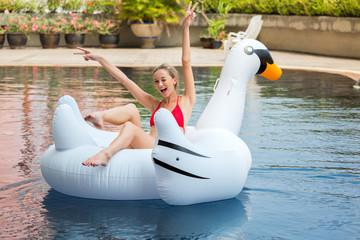 Bikini woman relaxation on swan