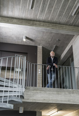 Mature businessman standing in staircase