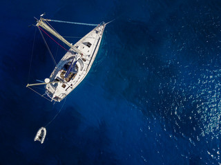 Top view of the white yacht in the exotic turquoise sea.