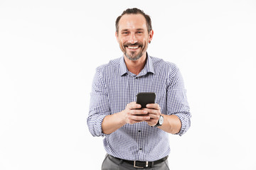 Cheerful adult man using mobile phone.