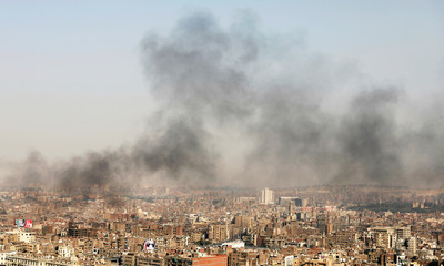 Black smoke from unknown source rises over Cairo