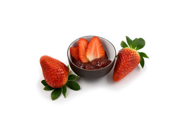 Strawberry jam stock images. Strawberry with jam on a white background. Marmalade in a bowl. Breakfast still life