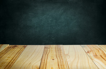 Wood table and blackboard background.