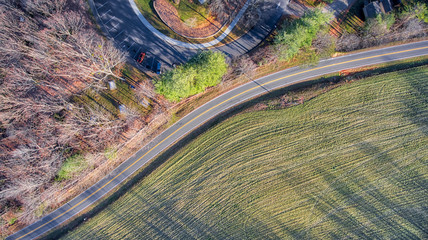 Looking down on road and green field