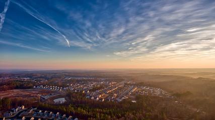 Colorful sunrise and clouds over suburban Durham North Carolina