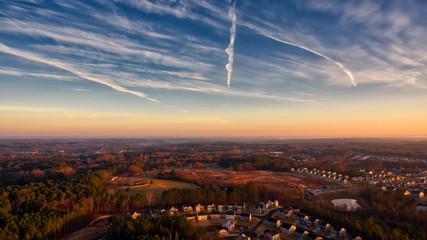 Contrails in sunrise sky suburbia Durham North Carolina