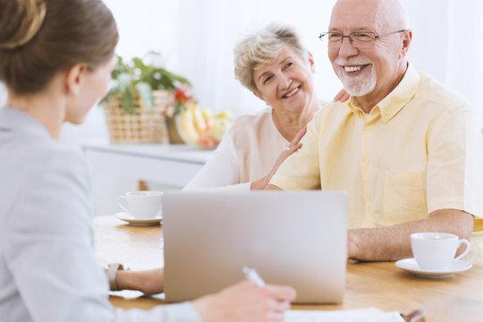 Happy seniors with insurance agent