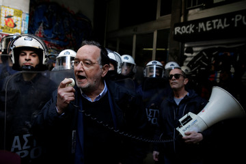 Demonstrators clash with riot police officers during a protest against home auctions in Athens