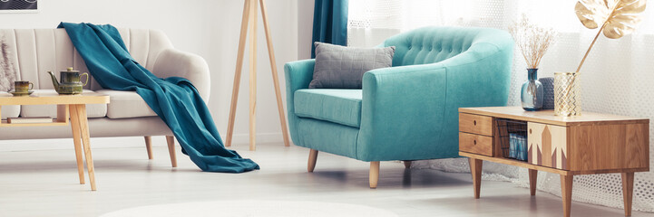 Turquoise armchair in living room