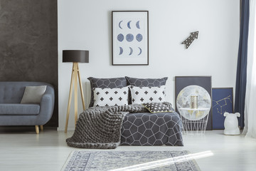 Sofa in navy blue bedroom