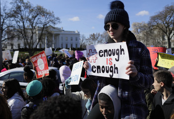 Students gather outside the  White House during walk-outs in support of stricter gun laws in Washington