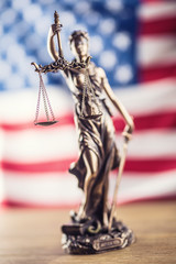 Lady Justice and American flag. Symbol of law and justice with USA Flag