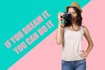 Cheerful female photographer posing for camera