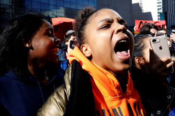 """Students from Fiorello H. Laguardia High School chant """"no more violence"""" in support of the National School Walkout in the Manhattan borough of New York City"""