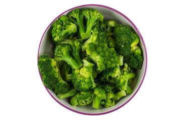 Cooked broccoli in glass bowl isolated on white background