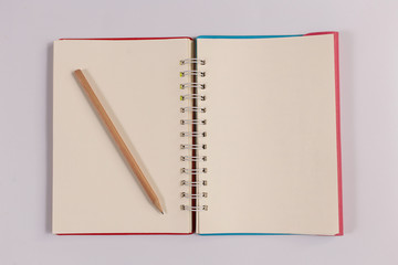 notebook with brown pencil, office concept top view
